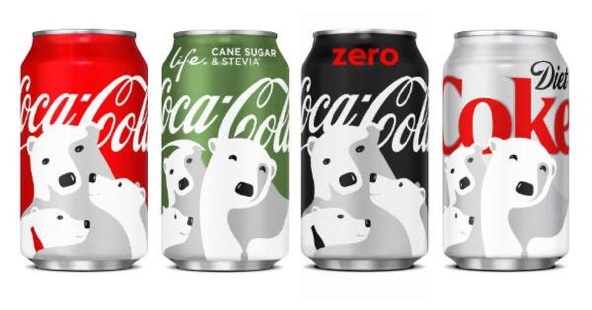 Coca-Cola разместила скрытые символы на рождественских банках.